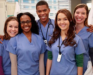 Grey S Anatomy Season 10 Cast Camilla Luddington And Gaius Charles Promoted To Series Regular Tvline