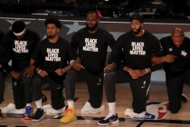 NBA Teams Kneel in Black Lives Matter Shirts as Interrupted Season Restarts