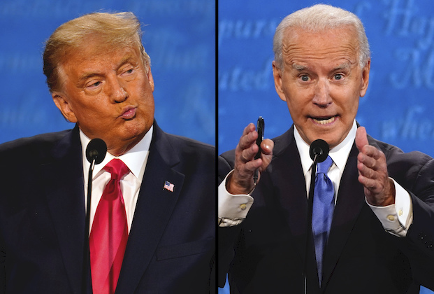 President Donald Trump reacts as he listens during the second and final presidential debate Thursday, Oct. 22, 2020, at Belmont University in Nashville, Tenn., with Democratic presidential candidate former Vice President Joe Biden. (AP Photo/Julio Cortez)