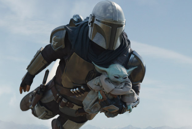 The Mandalorian (Pedro Pascal) and Grogu in Lucasfilm's THE MANDALORIAN, season two, exclusively on Disney+. © 2020 Lucasfilm Ltd. & ™. All Rights Reserved.
