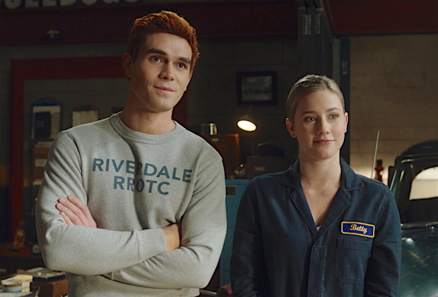 "Riverdale -- ""Chapter Eighty-Two: Back To School"" -- Image Number: RVD506fg_0001r -- Pictured (L-R): KJ Apa as Archie Andrews and Lili Reinhart as Betty Cooper -- Photo: The CW -- © 2021 The CW Network, LLC. All Rights Reserved."