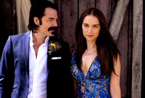 "WYNONNA EARP -- ""Old Souls"" Episode 412 -- Pictured: (l-r) Tim Rozon as Doc Holliday, Melanie Scrofano as Wynonna Earp -- (Photo by: Michelle Faye/Wynonna Earp Productions, Inc./SYFY)"