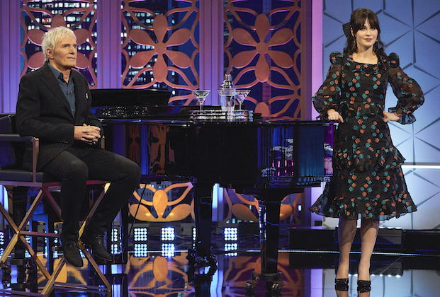 """CELEBRITY DATING GAME -""""Hannah Brown and Nicole Byer"""" – Hosted by actress and singer-songwriter Zooey Deschanel and multiple GRAMMY®-winning singer-songwriter Michael Bolton, """"The Celebrity Dating Game"""" offers a wry wink at modern dating with a star-studded roster of celebrities in their pursuit to find love. In the series premiere of """"The Celebrity Dating Game,"""" former Bachelorette and season 28 winner of """"Dancing with the Stars"""" Hannah Brown asks potential suitors to name a fun and romantic activity they can do at home, and Michael Bolton performs a hilarious parody of """"I Found Someone"""" to give her suitors some important clues. Meanwhile, comedian, actress and TV host Nicole Byer tests suitors by asking them, """"If I was a frozen pizza, how would you get me hot?"""" and Michael Bolton offers his rendition of """"Wind Beneath My Wings"""" to help the suitors figure out Byer's identity. The series premiere of """"The Celebrity Dating Game"""" airs MONDAY, JUNE 14 (10:00-11:00 p.m. EDT), on ABC. (ABC/Craig Sjodin) MICHAEL BOLTON, ZOOEY DESCHANEL"""