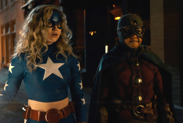 """DC's Stargirl -- """"Summer School: Chapter One"""" -- Image Number: STG201fg_0078r2.jpg -- Pictured (L-R): Brec Bassinger as Courtney Whitmore/Stargirl and Anjelika Washington as Beth Chapel/Dr. Mid-Nite-- Photo: The CW -- © 2021 The CW Network, LLC. All Rights Reserved."""