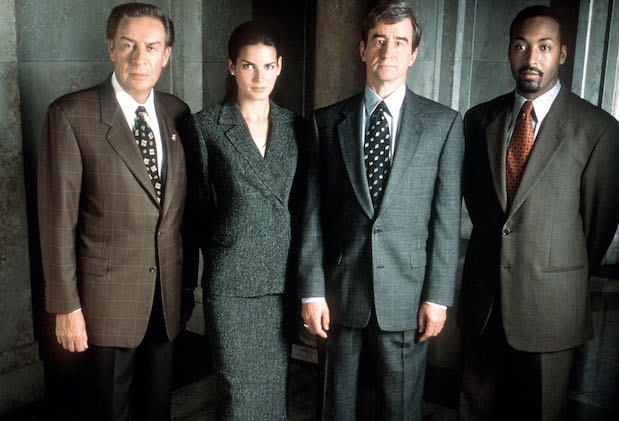 """The Cast Of """"Law & Order."""" From L-R: Jerry Orbach (As Det. Lennie Briscoe), Angie Harmon (As Asst. D.A. Abbie Carmichael), Sam Waterston (As Exec. Asst. D.A. Jack Mccoy) And Jesse L. Martin (As Det. Edward Green), November 1999. (Photo by Univeral International Television courtesy of Getty Images)"""